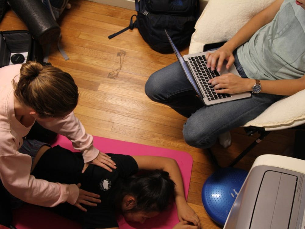First-years Lyndsay Hastings and Yuexuan Chen took turns giving back massages to help de-stress.