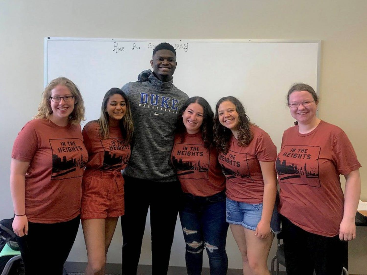 "Zion Williamson poses with ""In the Heights"" executive producer Shaina Lubliner and other members of the cast."