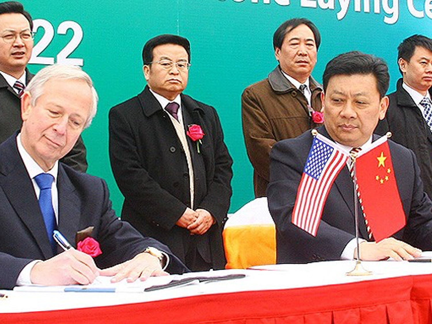 President Richard Brodhead signs an agreement finalizing Duke's expansion plans in Kunshan, China Jan. 22. With the agreement, the University enters into a partnership with Shanghai Jiao Tong University, which is accused of being involved in a series of cyberattacks on Google last month.