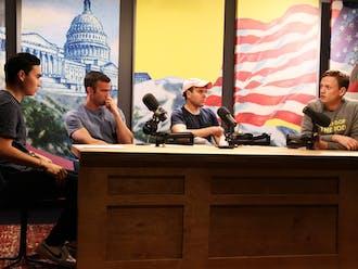 Duke sophomore Nick DeParle (left) with the hosts of Pod Save America. From left to right: Jon Favreau, Jon Lovett, Tommy Vietor.