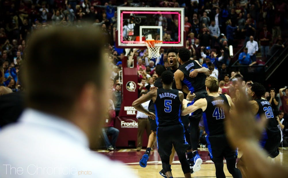 <p>Cam Reddish's triple with 0.8 seconds remaining sent Duke to victory Saturday.</p>