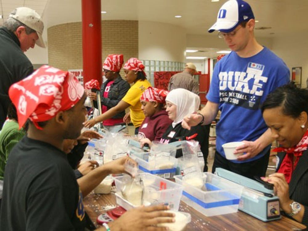 During the annual MLK Million Meals Service Event, local community members and Duke students pack meals for victims of the earthquake in Haiti. The volunteers packed a total of 50,000 meals Wednesday evening.