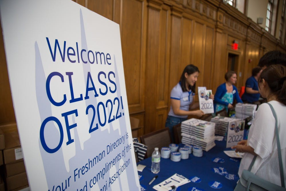<p>Freshman receive their Class of 2022 Directory, DukeCard, and other first-year information inside Marketplace on East Campus.&nbsp;</p>