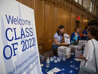 Freshman receive their Class of 2022 Directory, DukeCard, and other first-year information inside Marketplace on East Campus.