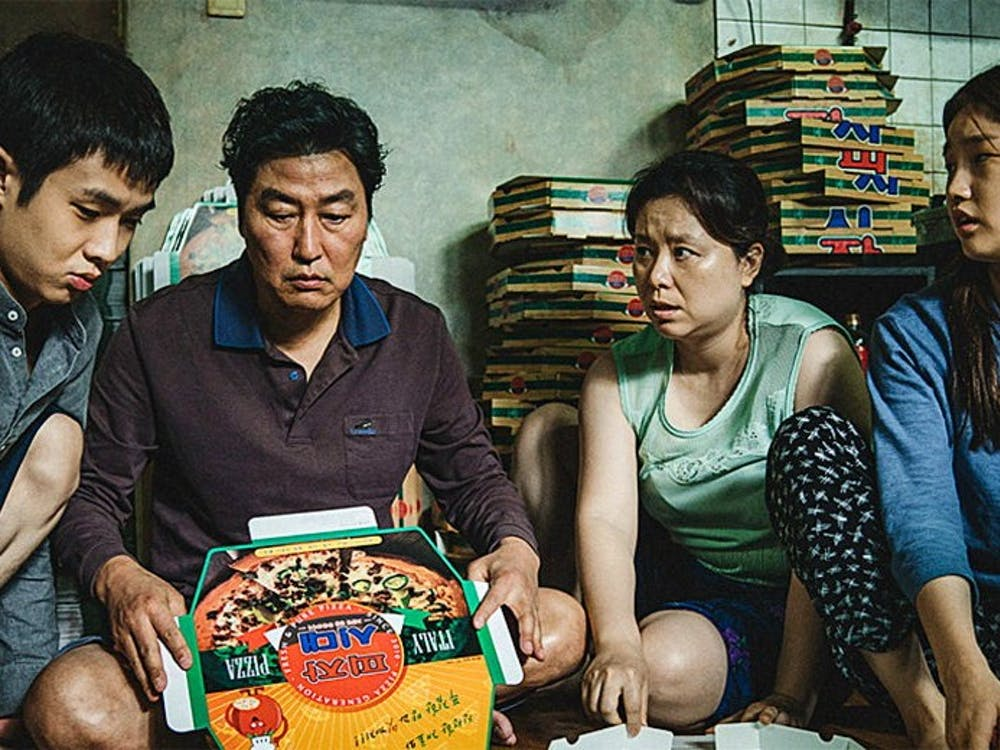 """Parasite"" follows the financially-struggling Kim family."