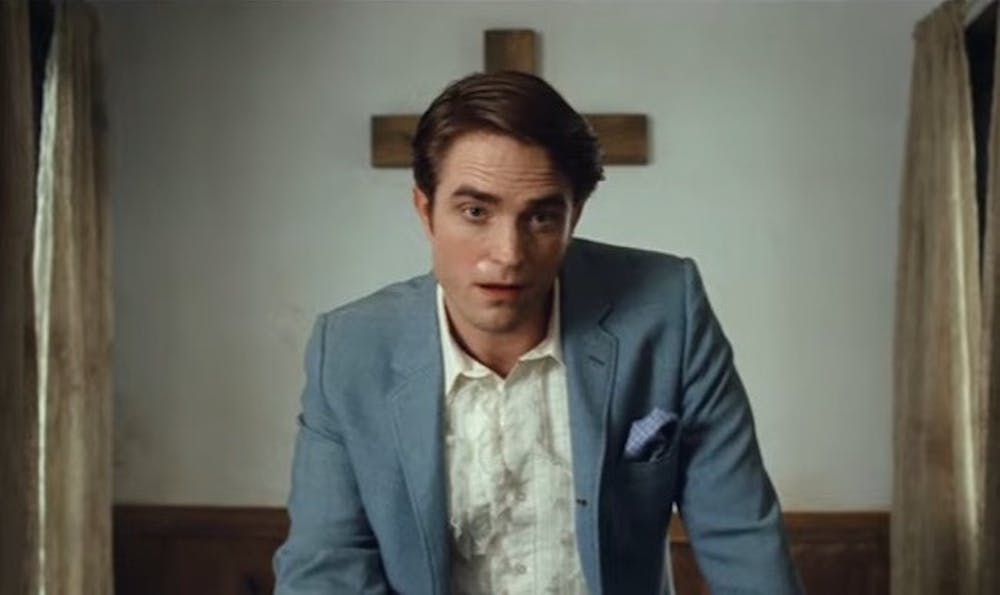 """<p>Not even standout performances and Robert Pattinson's delightfully ridiculous accent can rescue """"Devil All the Time"""" from tedium.</p>"""
