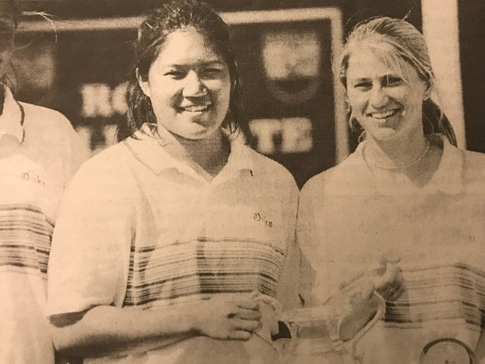 Chuasiriporn(left) smiling after the BlueDevils captured their third consecutive ACC Championship in 1998.