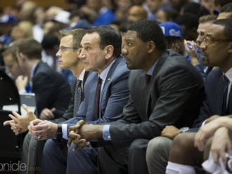 Associate head coach Nate James (third from left) provided some insight as to who could make up the Blue Devils' starting five to begin the season.