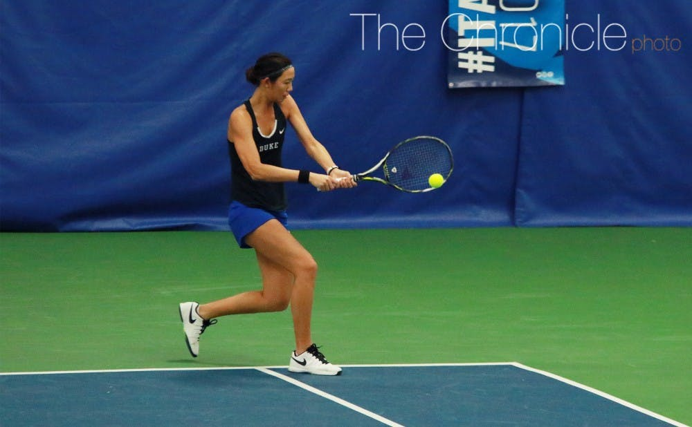 <p>Freshman Meible Chi and the Blue Devils knocked off  No. 16 N.C. State on the road Wednesday afternoon.</p>