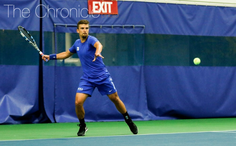 <p>Senior TJ Pura and the Blue Devils&nbsp;looked sharp in their first two outdoor matches of 2017.&nbsp;</p>