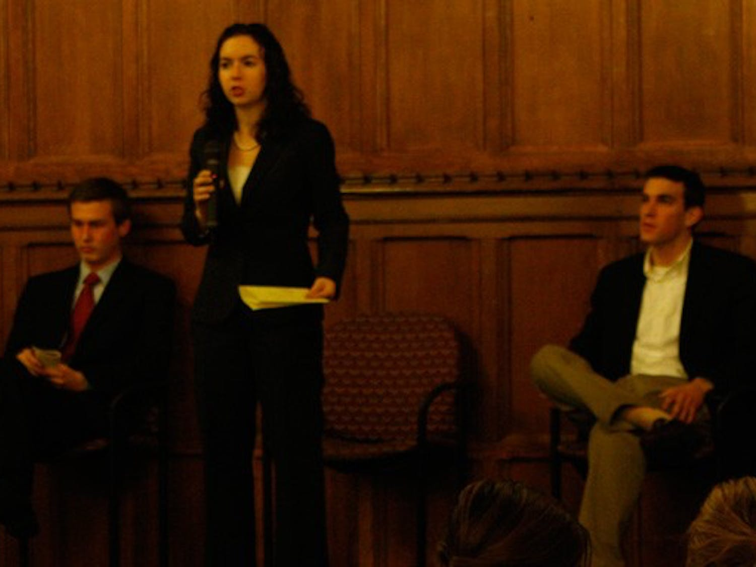 Young Trustee Finalists Zach Perret (left), Chelsea Goldstein (center) and John Harpham (right) participate in a public debate Wednesday night.