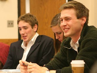 DUU President Zachary Perret approves the budget for this year's LDOC celebration, which includes a $5000 loan, at Tuesday's DUU meeting.