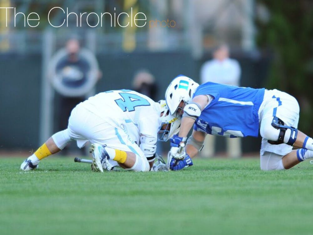 Senior Kyle Rowe's dominance at the faceoff X turned the tide of Sunday's rivalry game—at one point, he won 17 of 18 faceoffs to keep the Blue Devils in attack mode.