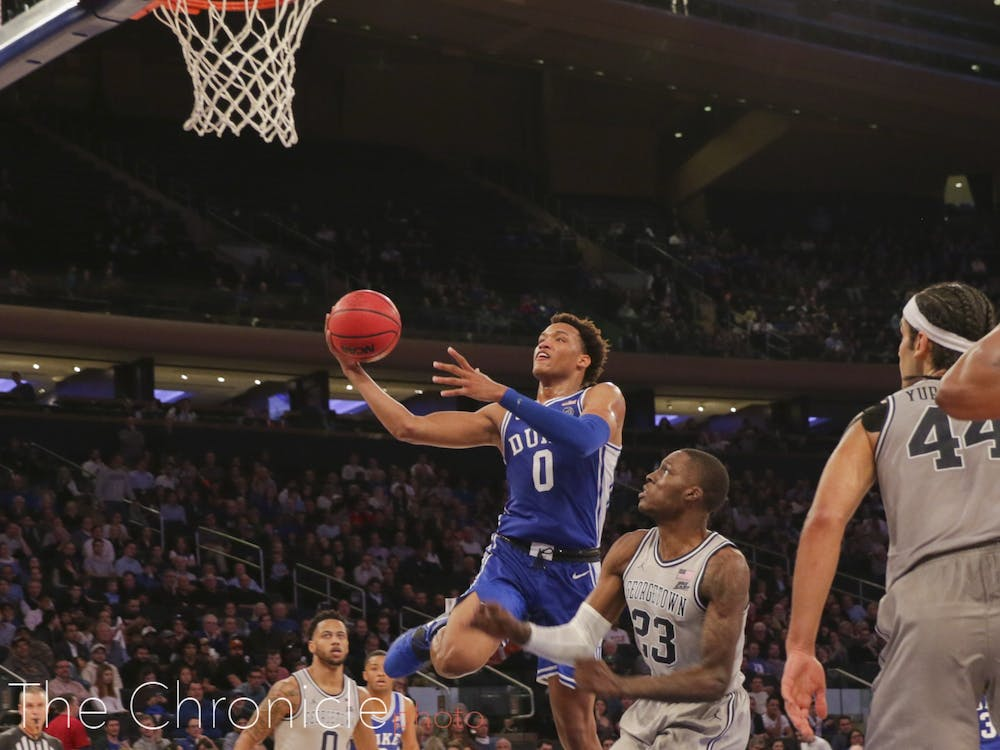 <p>Wendell Moore navigated through, around and over Georgetown's defense en route to 17 points in Duke's 2K Empire Classic championship game victory.</p>