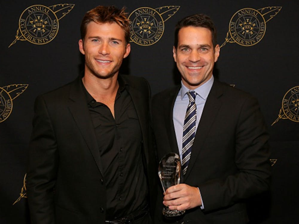 BEVERLY HILLS, CA - FEBRUARY 20:  Scott Eastwood (L) and Dave Karger pose with the Press Award backstage at the 52nd Annual ICG Publicists Awards at The Beverly Hilton Hotel on February 20, 2015 in Beverly Hills, California.  (Photo by Mathew Imaging/WireImage)