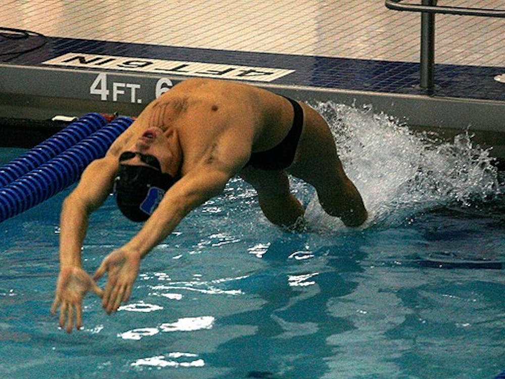 Duke's men topped Queens University, but fell 165-135 to South Carolina.