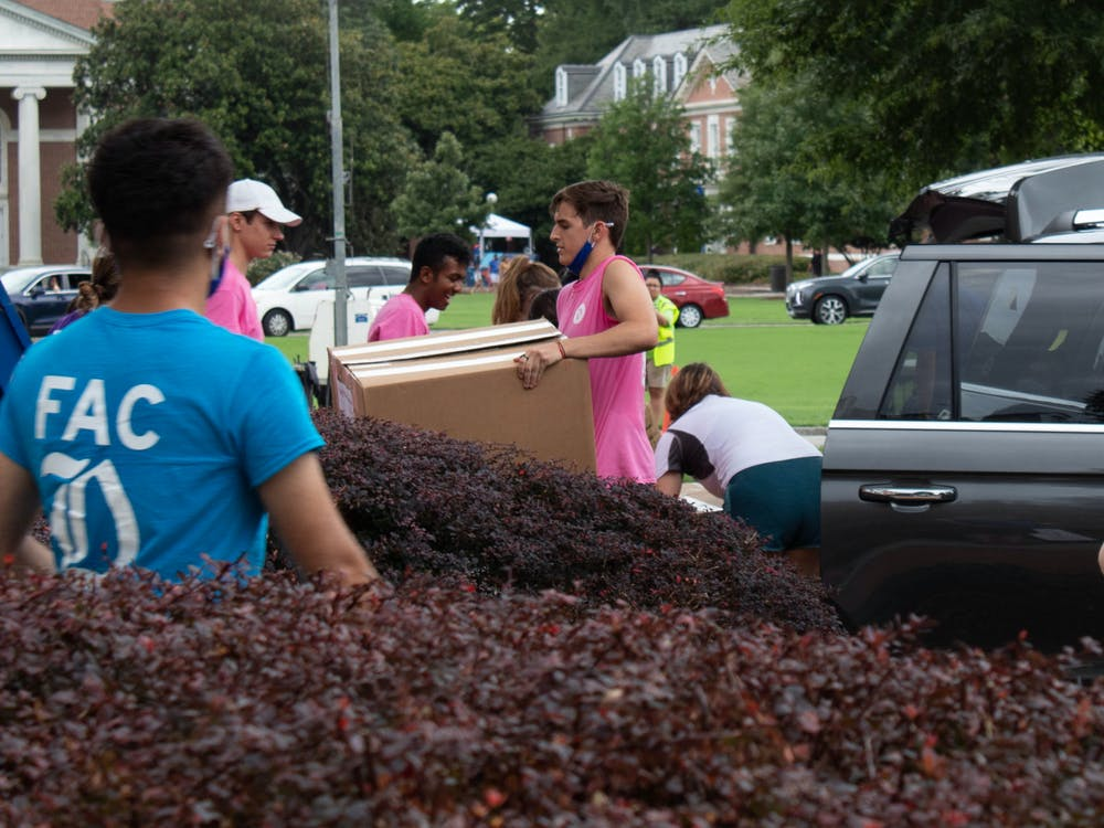 First-year advisory counselors move students' belongings into Giles dorm on Tuesday, move-in day for the Class of 2025.