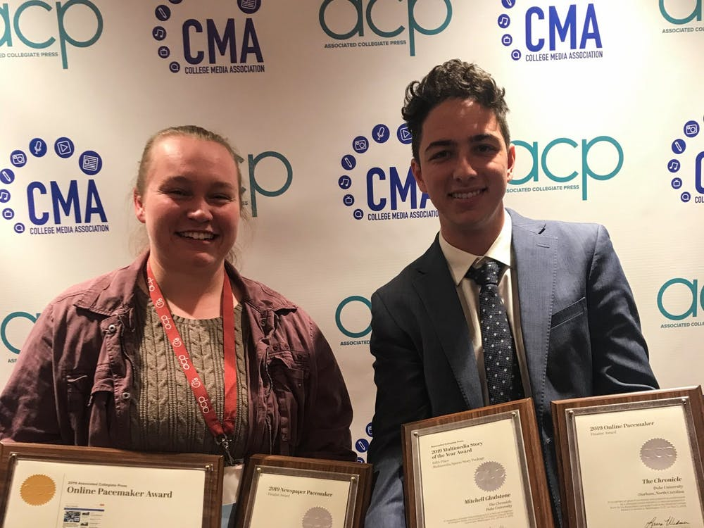 Vol. 114 Editor Bre Bradham and Vol. 114 Managing Editor Ben Leonard with the plaques from the ACP conference.