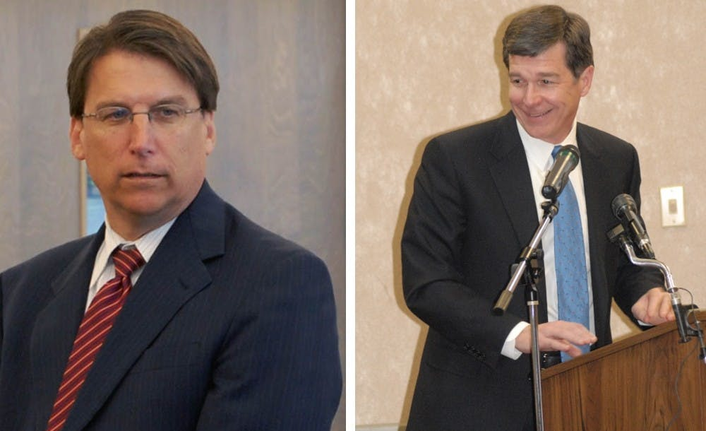 <p>Governor Pat McCrory (left) formally conceded the gubernatorial&nbsp;race to Democrat Roy Cooper (right).</p>
