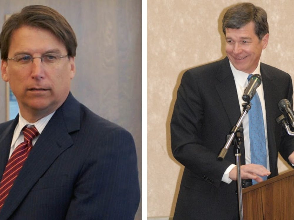 Governor Pat McCrory (left) formally conceded the gubernatorial race to Democrat Roy Cooper (right).