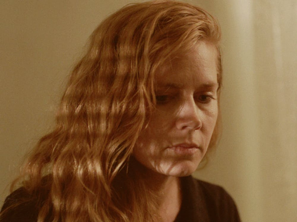 "Amy Adams stars as Camille Preaker in the television adaptation of Gillian Flynn's novel ""Sharp Objects."""