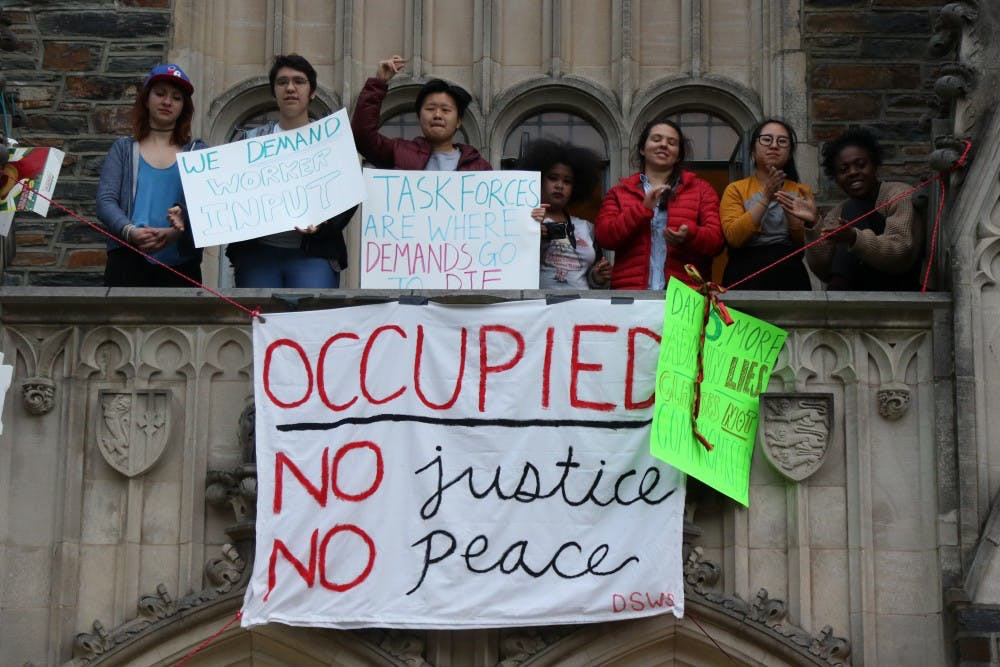 <p>Allen Building sit-in students came out of the building with new signs Wednesday criticizing the University's many task forces in response to demands.</p>