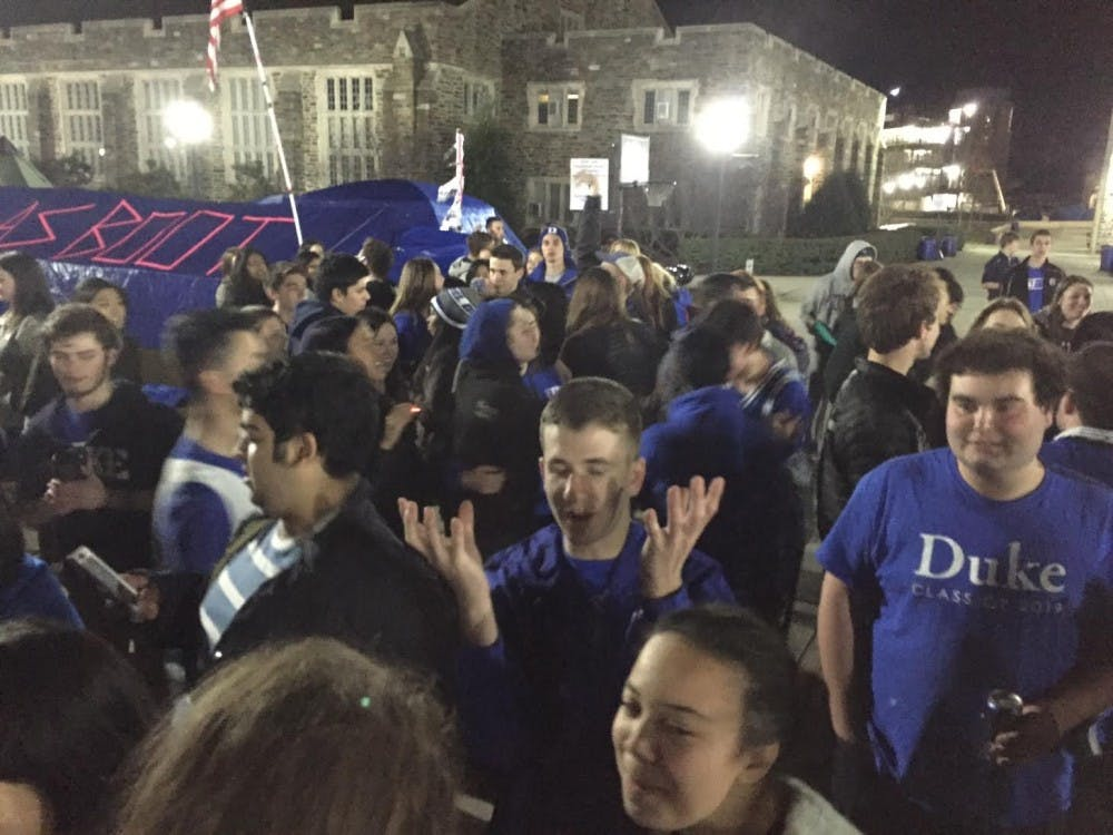 Students waited for the Blue Devils to arrive following their win at Chapel Hill early Thursday morning.