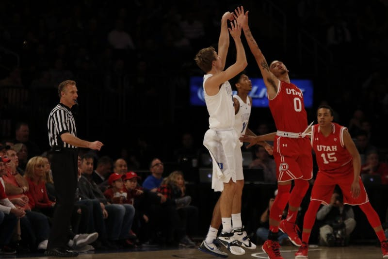 Freshman Luke Kennard scored a career-high 24 points—including a 4-point play with less than 10 seconds remaining in overtime—but the Blue Devils shot just 29.9 percent from the floor as a team.