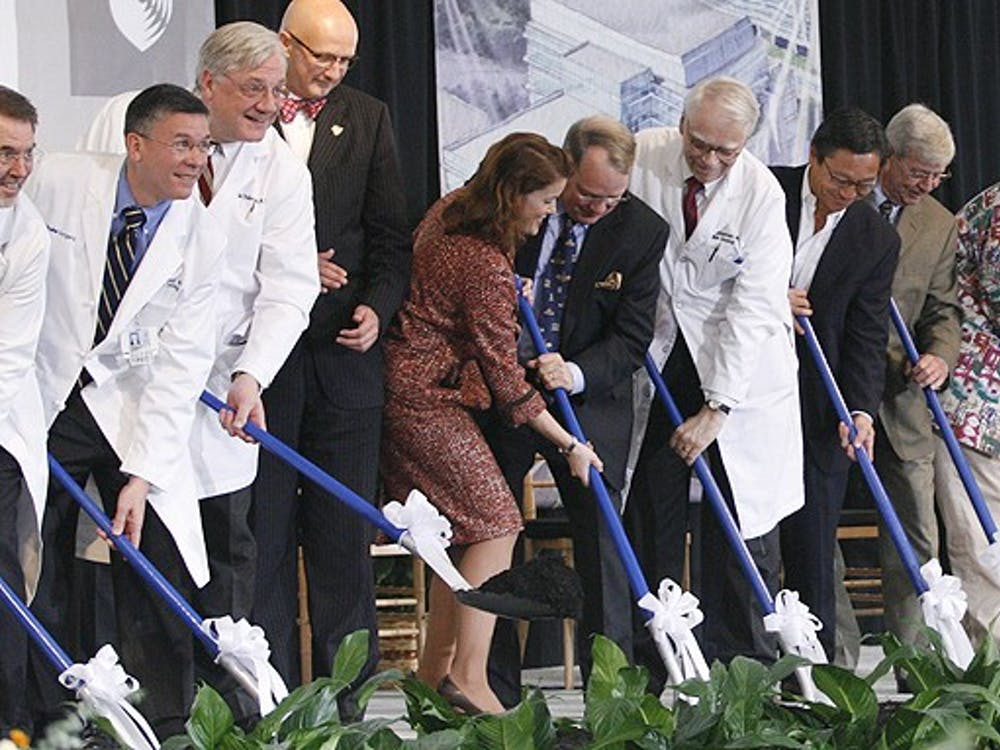 Officials from the state, the University and Duke University Health System participate in a ceremony that symbolizes the ground-breaking of DUHS' new cancer center Friday afternoon.