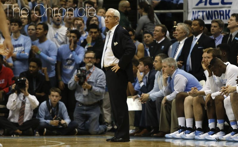 Roy Williams coaches North Carolina before his orange juice revelation.