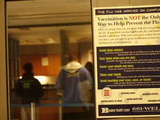 A sign outside the Student Health Center informs visitors of alternative ways to prevent contracting swine flu without receiving vaccination.