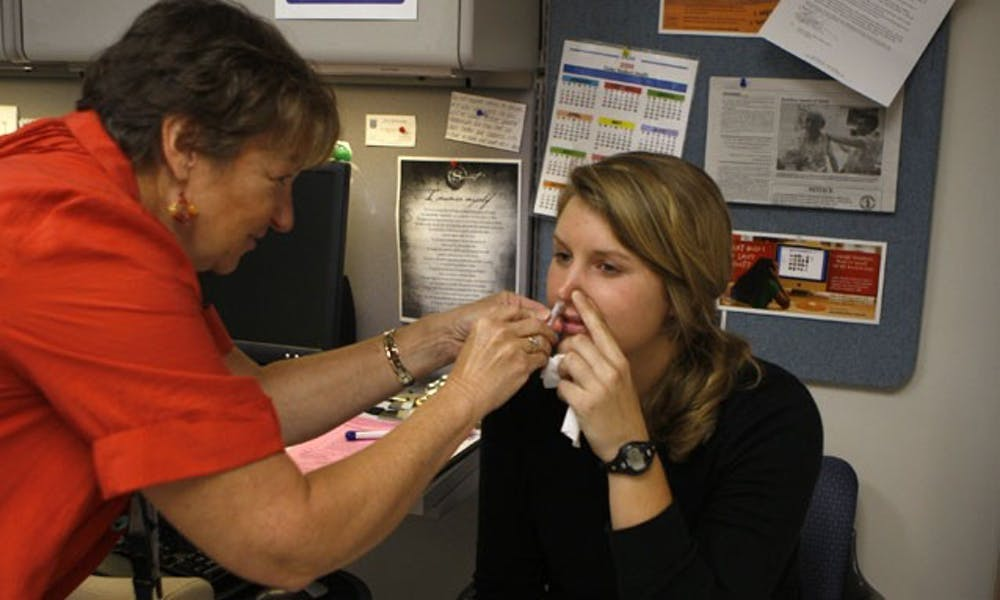 A student receives a FluMist nasal spray vaccine Tuesday at the Student Health Center. Duke received its first shipment of the vaccine last week.