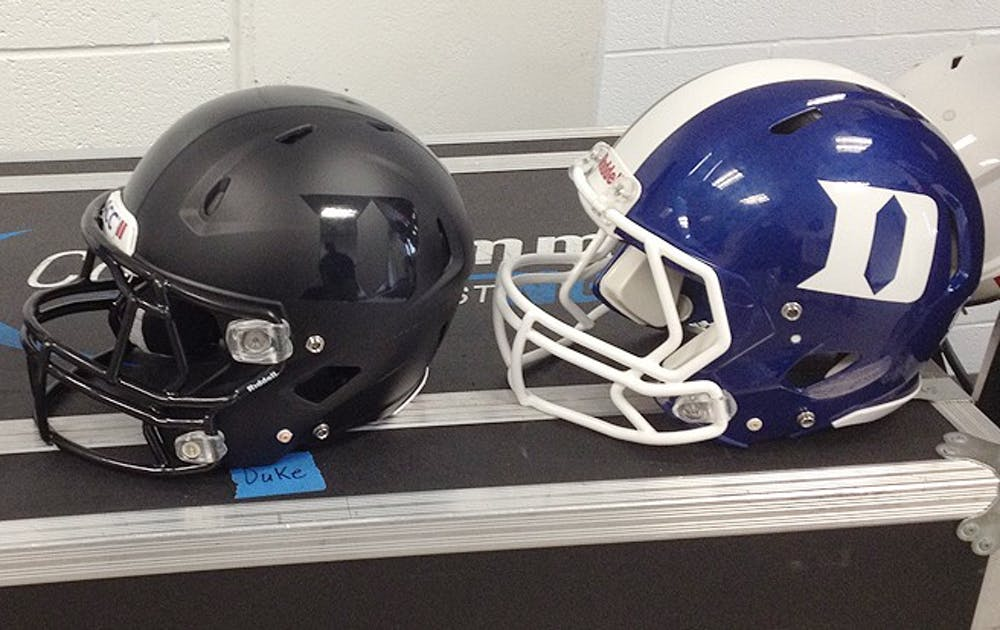 The Duke football team unveiled two new sets of helmets, black and blue ones, this summer. The Blue Devils first wore black uniforms last season.