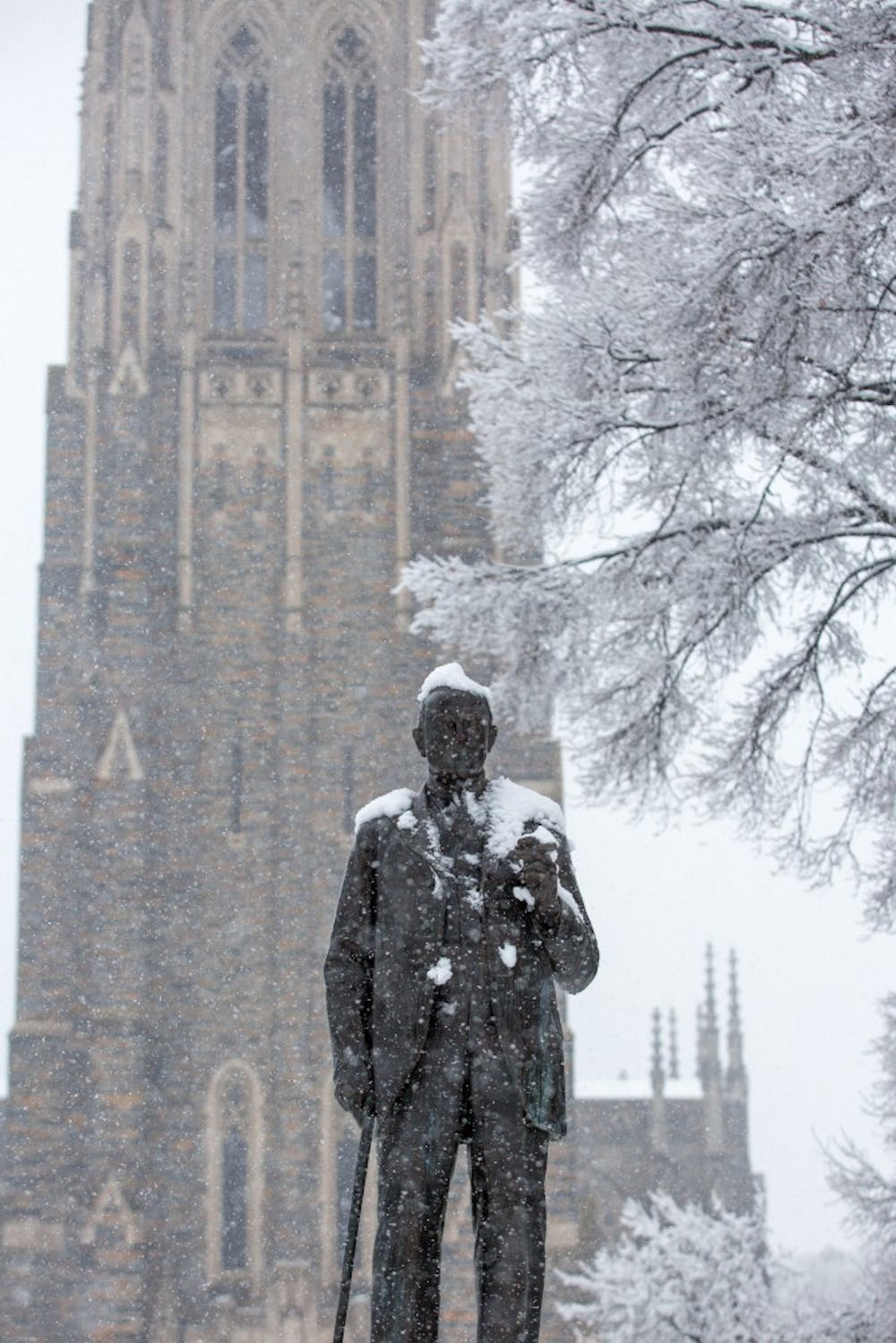 James B. Duke statue on Abele Quad gets a light dusting on Tuesday morning.
