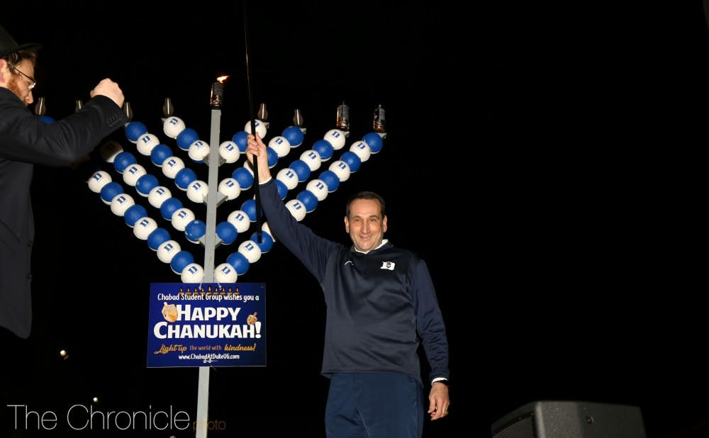 <p>Mike Krzyzewski celebrated the second night of Hanukkah on campus.</p>