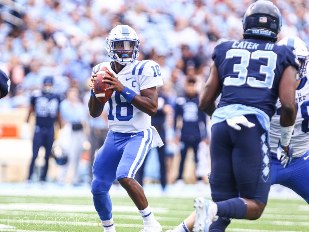 <p>Quentin Harris completed 22-of-39 passes for 229 yards, one touchdown and one interception in the sloppy contest</p>