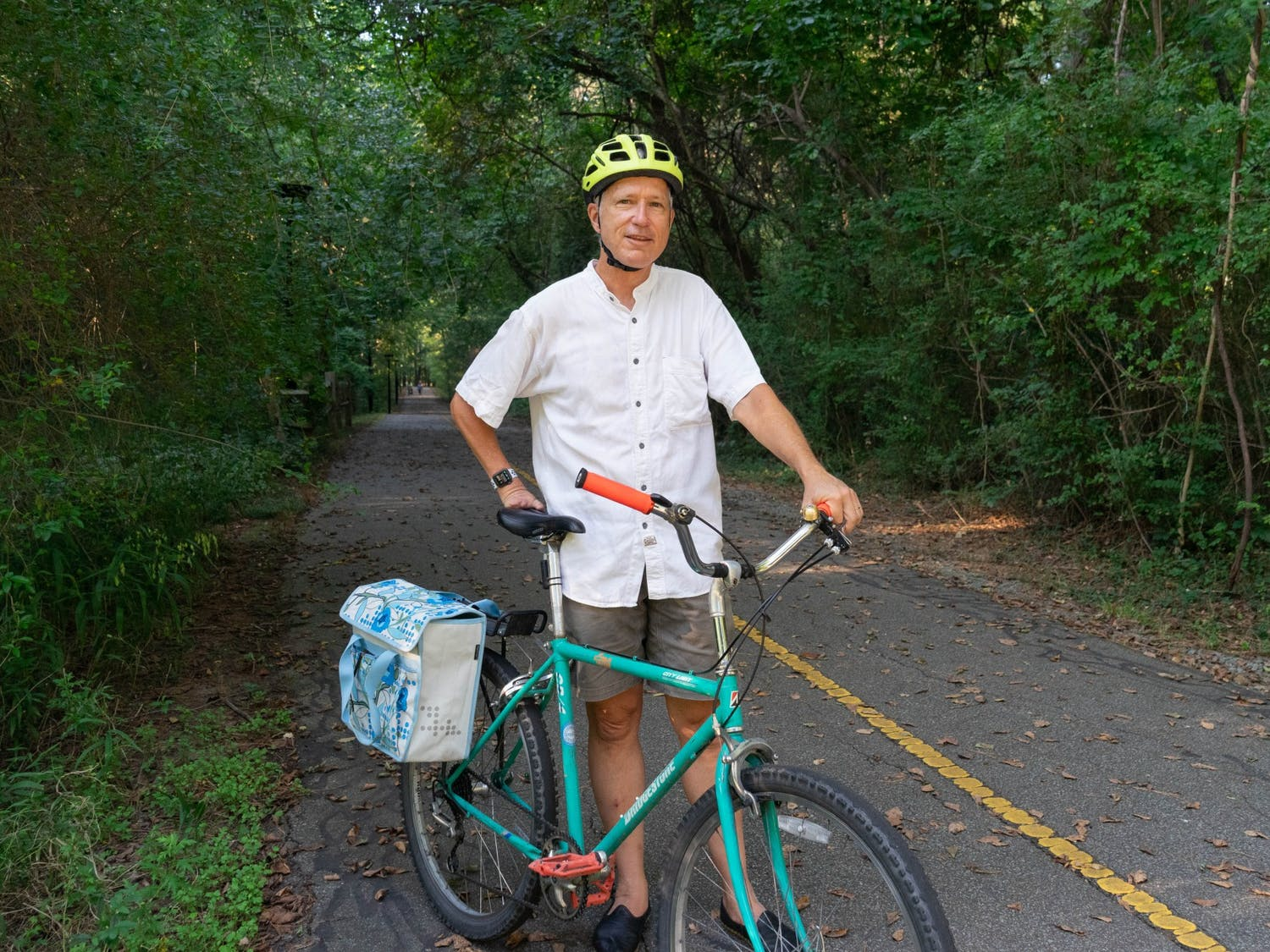 John Rees, President of Bicycle Alliance of Chapel Hill, poses with his bike on the Frances Shetley bikeway, which is a part of the 17-mile, shared-use path.