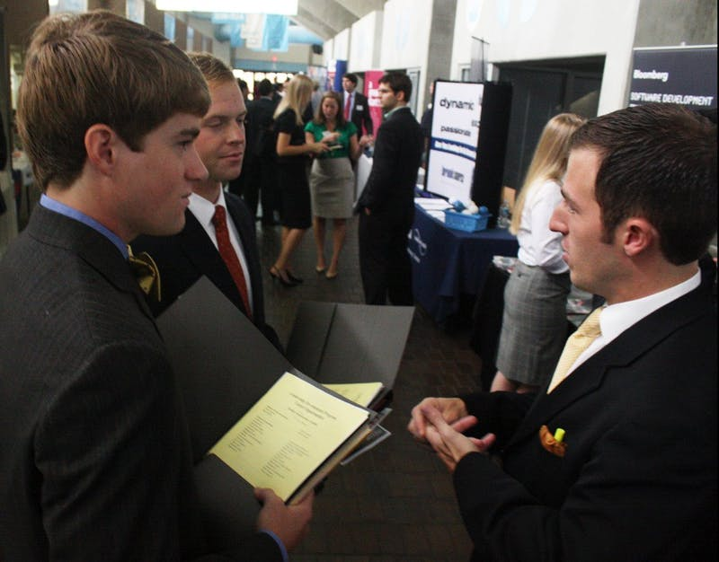 """Arthur McCaul and Allen Clark talk with Christian Corts of BB&T at a career exposition held last Spring. University Career Services will host """"How to Find an Internship,"""" a similar event, on Sept. 20 in Hanes Hall."""