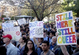 Protestors gather at the Peace and Justice Plaza Tuesday afternoon to speak out against House Bill 2.