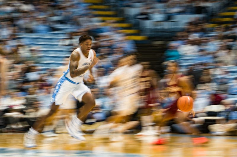 First-year forward Garrison Brooks (!5) runs after ball in basketball game against Elon University on Thursday, Nov. 20, 2019. UNC won 75-61.
