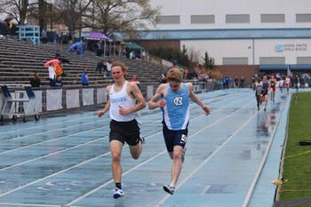 Noah Shore (right) of UNC sprints out final stretch at the Fetzer Field track.
