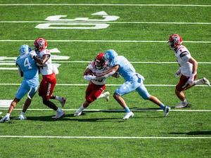 UNC junior linebacker Jeremiah Gemmel (44) tackles NC State sophomore running back Jordon Houston (20) in Kenan Stadium Oct. 24, 2020. The Tar Heels beat the Wolfpack 48-21.