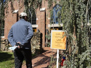 A Chapel Hill resident waits at the Early Voting line at Chapel of the Cross on Franklin Street on Thursday, Oct. 15, 2020.