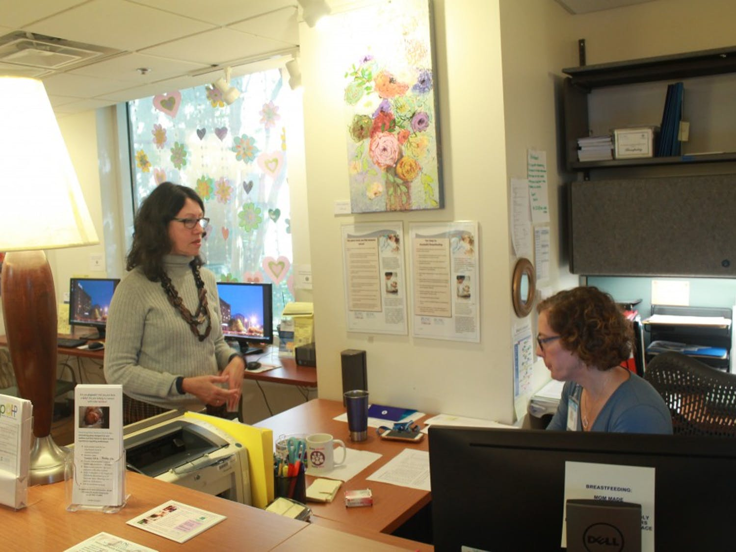 Health Education Director of the Women's Health Information Center Mary Quezada and Health Education Coordinator Sue Duronio discuss issues within the UNC Women's Center on Monday, Oct. 22.