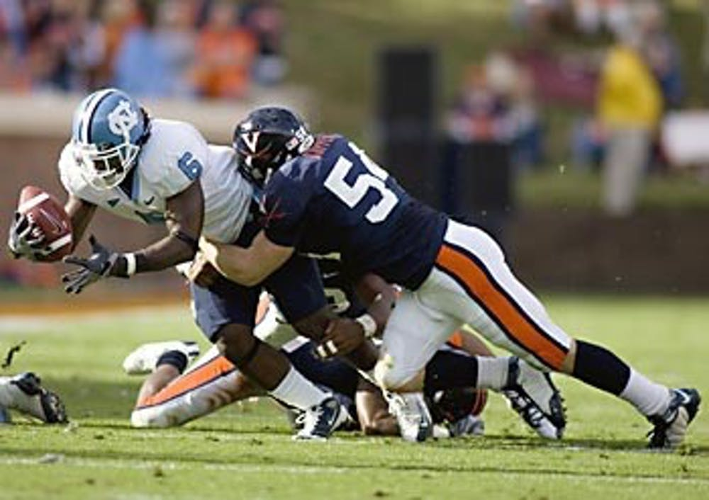 Tar Heels struggle to _¶ nish in UVa. territory