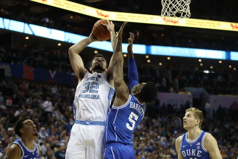Duke first-year forward RJ Barrett (5) blocks UNC senior forward Luke Maye (32) during the semifinals of the ACC Tournament at the Spectrum Center in Charlotte, N.C. on Friday, March 15, 2019. UNC fell to Duke 73-74.