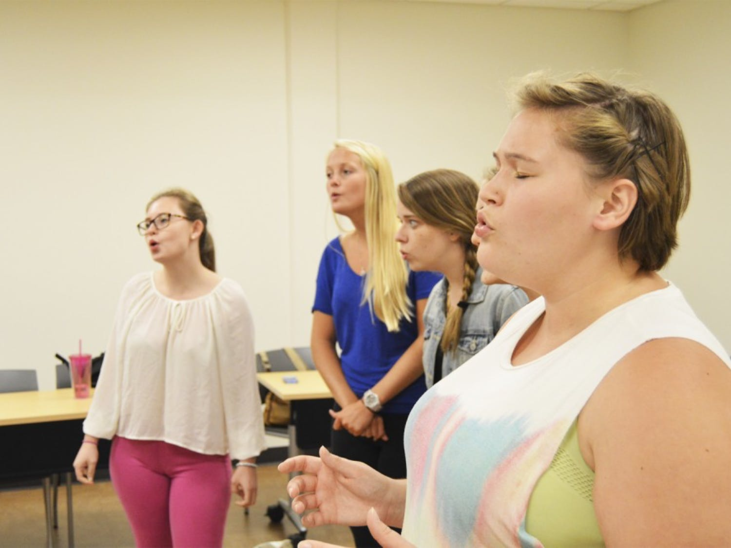 """(From right) Valerie Sauer, Susanna Trotter, Taylor Lingle and Katie Arney practice their rendition of """"Love Runs Out"""" by One Republic in preparation for Monday's Sunset Serenade."""