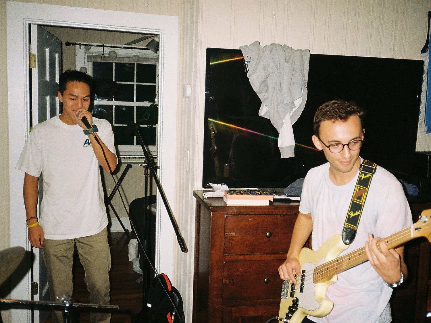 Bryan Truong and Conner Mann practicing in their North Street house. Truong and Mann are a part of the 5 member Northbounds, a local band that frequents Chapel Hill bars, rooftops, tailgates and more. Photo courtesy of Bryan Truong.