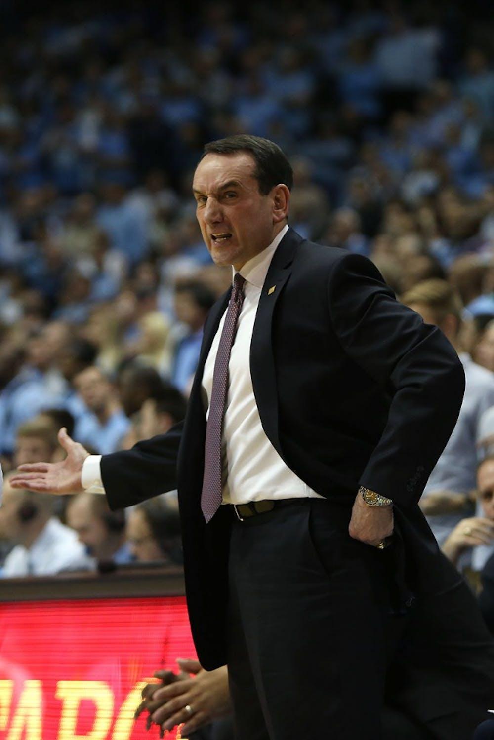 <p>Duke's Coach Krzyzewski shouts at the referee.&nbsp;</p>