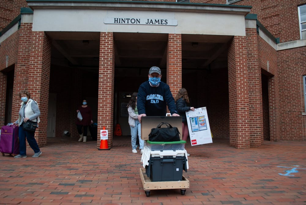 First-year students return to on-campus housing at Hinton James Residence Hall for UNC's spring semester on Saturday, Jan. 16, 2021.